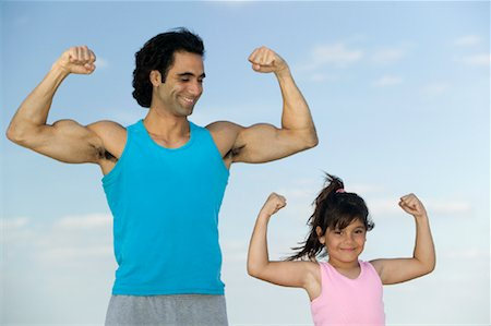 Portrait of Father and Daughter Flexing Muscles Stock Photo - Rights-Managed, Code: 700-01124058
