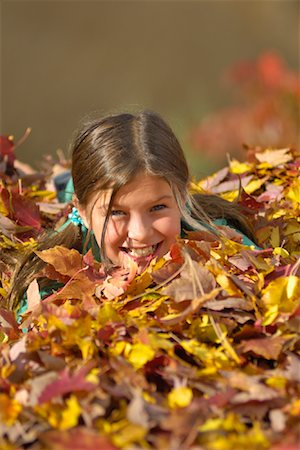 pile leaves playing - Girl Playing in Leaves Stock Photo - Rights-Managed, Code: 700-01124510