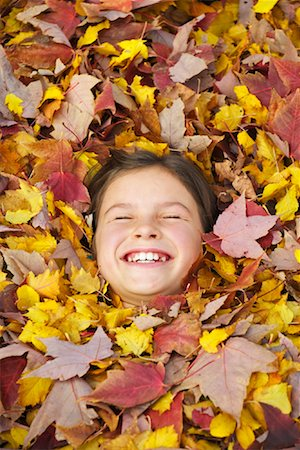 pile leaves playing - Girl Lying in Leaves Stock Photo - Rights-Managed, Code: 700-01124513