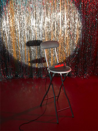 Empty Chair and Microphone on Stage Stock Photo - Rights-Managed, Code: 700-01120573