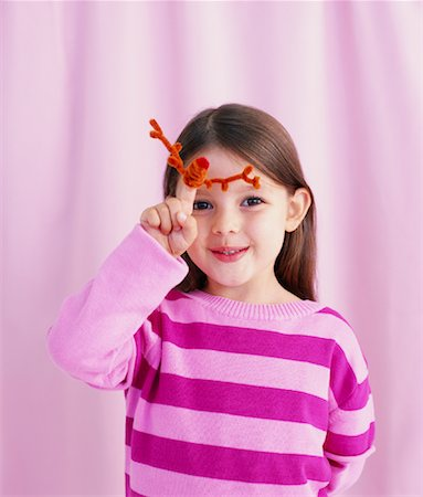 Portrait of Girl with Pipecleaner Reindeer Stock Photo - Rights-Managed, Code: 700-01120604
