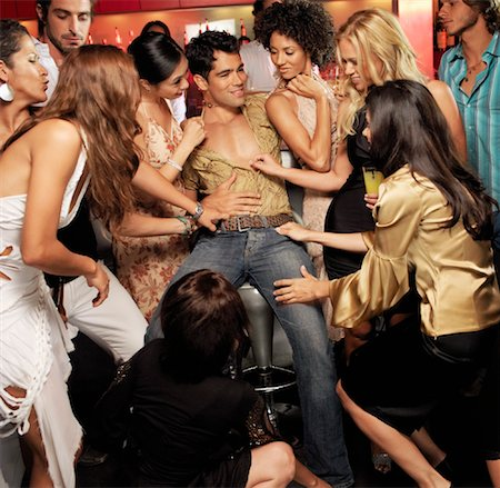 sexually aroused woman - Women Undressing Man in Bar Stock Photo - Rights-Managed, Code: 700-01164966