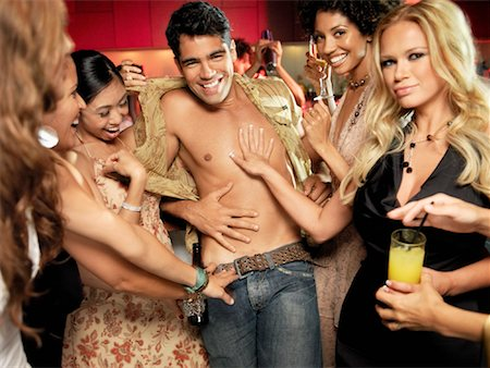 sexually aroused woman - Women Undressing Man in Bar Stock Photo - Rights-Managed, Code: 700-01164967