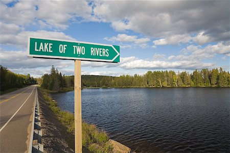 road landscape - Road Sign and Lake of Two Rivers, Algonquin Provincial Park, Ontario, Canada Stock Photo - Rights-Managed, Code: 700-01163243