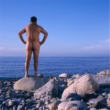 Naked Man Standing on Beach Stock Photo - Rights-Managed, Code: 700-01163568