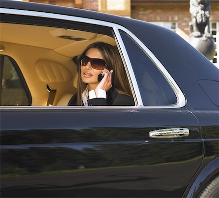 Woman in Backseat of Limousine Stock Photo - Rights-Managed, Code: 700-01172492