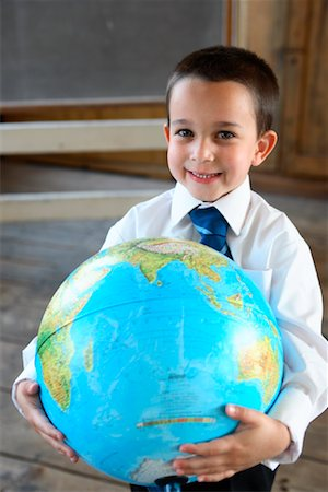 Boy in Schoolhouse with Globe Stock Photo - Rights-Managed, Code: 700-01173178