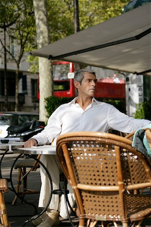 Man Sitting in Cafe, Paris, France Stock Photo - Rights-Managed, Code: 700-01173208