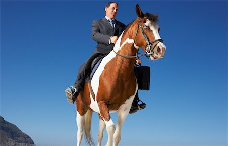 Businessman Riding Horse Stock Photo - Rights-Managed, Code: 700-01185196