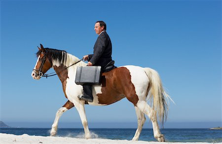 Businessman Riding Horse to Work Stock Photo - Rights-Managed, Code: 700-01185198