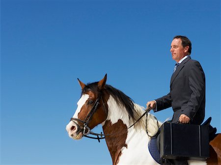 Businessman Riding Horse to Work Stock Photo - Rights-Managed, Code: 700-01185199