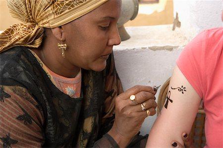 draw black women - Tattoo Artist Giving a Woman a Henna Tattoo, Aswan, Egypt Stock Photo - Rights-Managed, Code: 700-01182759