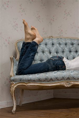 Woman Lying on Sofa Stock Photo - Rights-Managed, Code: 700-01183249