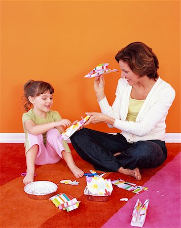Mother and Daughter Making Paper Airplanes Stock Photo - Rights-Managed, Code: 700-01194574
