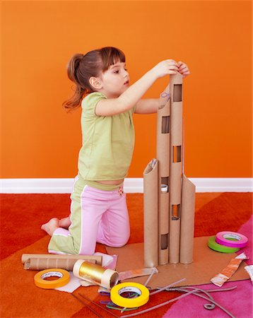 Girl Making Cardboard Tower Stock Photo - Rights-Managed, Code: 700-01194575