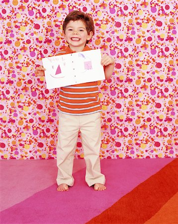 Boy Showing Picture Stock Photo - Rights-Managed, Code: 700-01194577