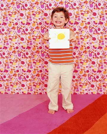 Boy Showing Picture Stock Photo - Rights-Managed, Code: 700-01194578