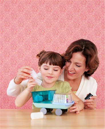 Mother and Daughter Making Crafts Stock Photo - Rights-Managed, Code: 700-01194573