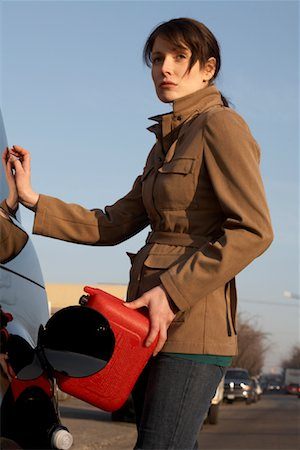 stalled car - Woman Filling Gas Tank Stock Photo - Rights-Managed, Code: 700-01194743