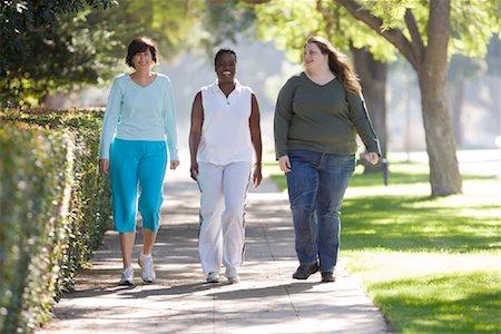 Three Women Walking Stock Photo - Rights-Managed, Code: 700-01199337