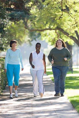 Three Women Walking Stock Photo - Rights-Managed, Code: 700-01199338