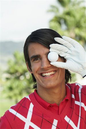 Portrait of Man Holding Golf Ball Stock Photo - Rights-Managed, Code: 700-01199588