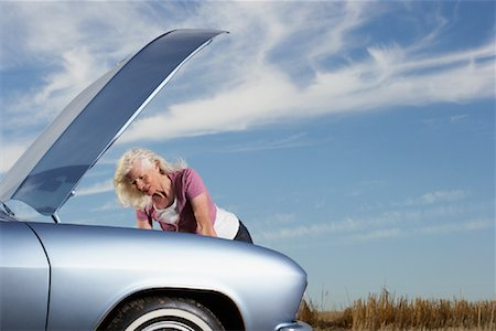 stalled car - Woman Looking Under Hood of Stalled Car Stock Photo - Rights-Managed, Code: 700-01199946