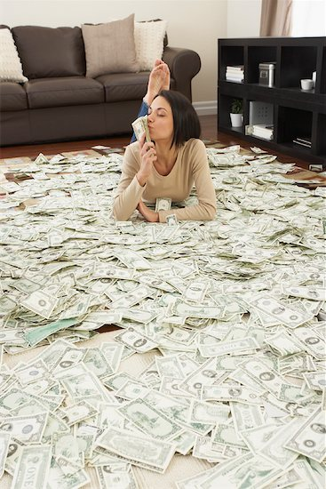 Woman at Home with Pile of Money Stock Photo - Premium Rights-Managed, Artist: Jerzyworks, Image code: 700-01200187