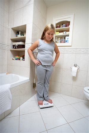 Girl Using Scale Stock Photo - Rights-Managed, Code: 700-01200256