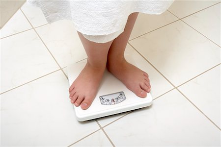 Girl Standing on Scale Stock Photo - Rights-Managed, Code: 700-01200265