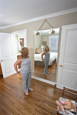 Girl Looking in Mirror Stock Photo - Rights-Managed, Code: 700-01200266