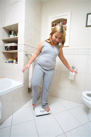 Girl Using Scale Stock Photo - Rights-Managed, Code: 700-01200262
