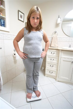 Girl Standing on Scale Stock Photo - Rights-Managed, Code: 700-01200263