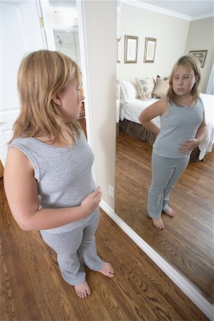 Girl Looking in Mirror Stock Photo - Rights-Managed, Code: 700-01200272