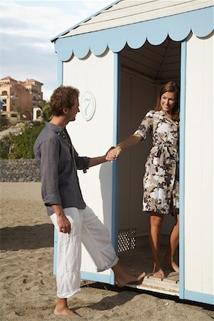 Woman Leading Man into Change Room Stock Photo - Rights-Managed, Code: 700-01200444