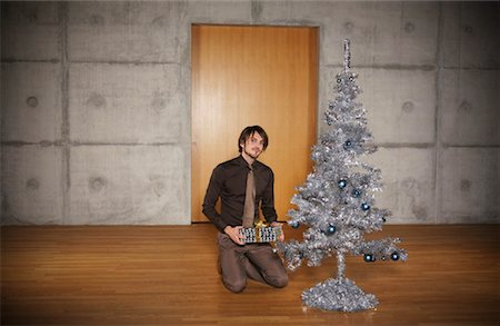 silver box - Portrait of Man with Christmas Tree Stock Photo - Rights-Managed, Code: 700-01223818
