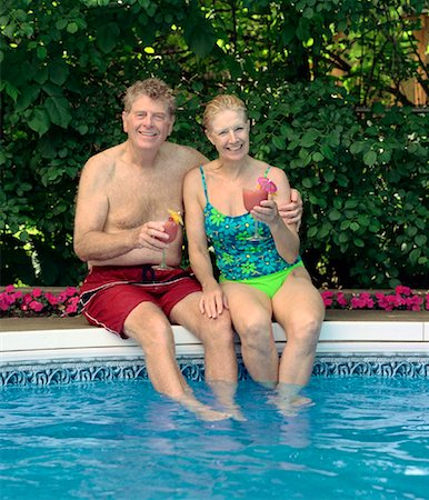 seniors woman in swimsuit - Couple Sitting on Pool Side Stock Photo - Rights-Managed, Code: 700-01234761