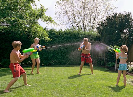 seniors woman in swimsuit - Family Having Water Fight Stock Photo - Rights-Managed, Code: 700-01234779