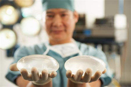 Doctor Holding Implants Stock Photo - Rights-Managed, Code: 700-01234809