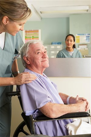 Nurse with Patient in Wheelchair Stock Photo - Rights-Managed, Code: 700-01236086