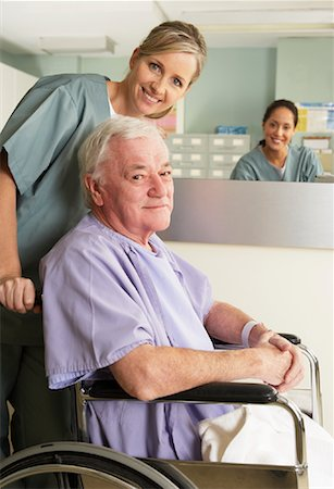 Nurse with Patient in Wheelchair Stock Photo - Rights-Managed, Code: 700-01236087