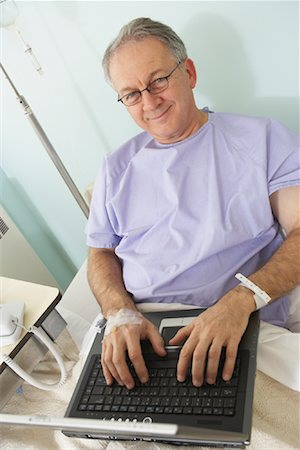 Man in Hospital Bed Stock Photo - Rights-Managed, Code: 700-01236104