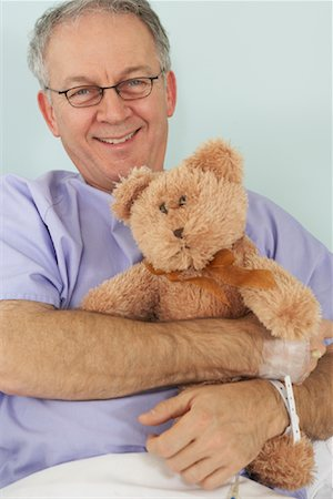 Man in Hospital Bed, Holding Teddy Bear Stock Photo - Rights-Managed, Code: 700-01236105