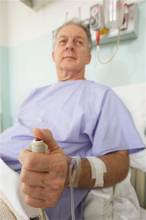 Man in Hospital Bed Stock Photo - Rights-Managed, Code: 700-01236114