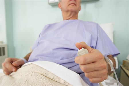 Man in Hospital Bed Stock Photo - Rights-Managed, Code: 700-01236115