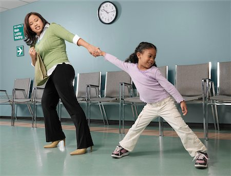 Mother Dragging Daughter to See the Doctor Stock Photo - Rights-Managed, Code: 700-01236169