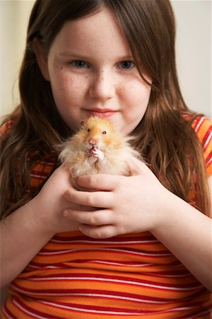 Portrait of Girl Holding Hamster Stock Photo - Rights-Managed, Code: 700-01236575