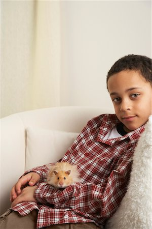 Boy Holding Hamster Stock Photo - Rights-Managed, Code: 700-01236594