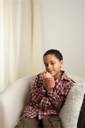 Boy Holding Hamster Stock Photo - Rights-Managed, Code: 700-01236595