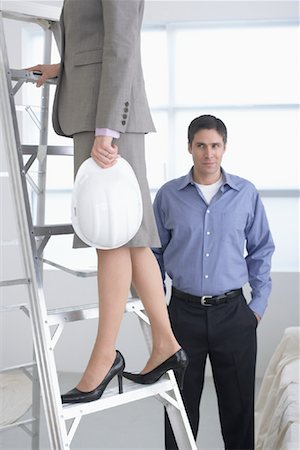 Man Looking at Businesswoman on Construction Site Stock Photo - Rights-Managed, Code: 700-01248618